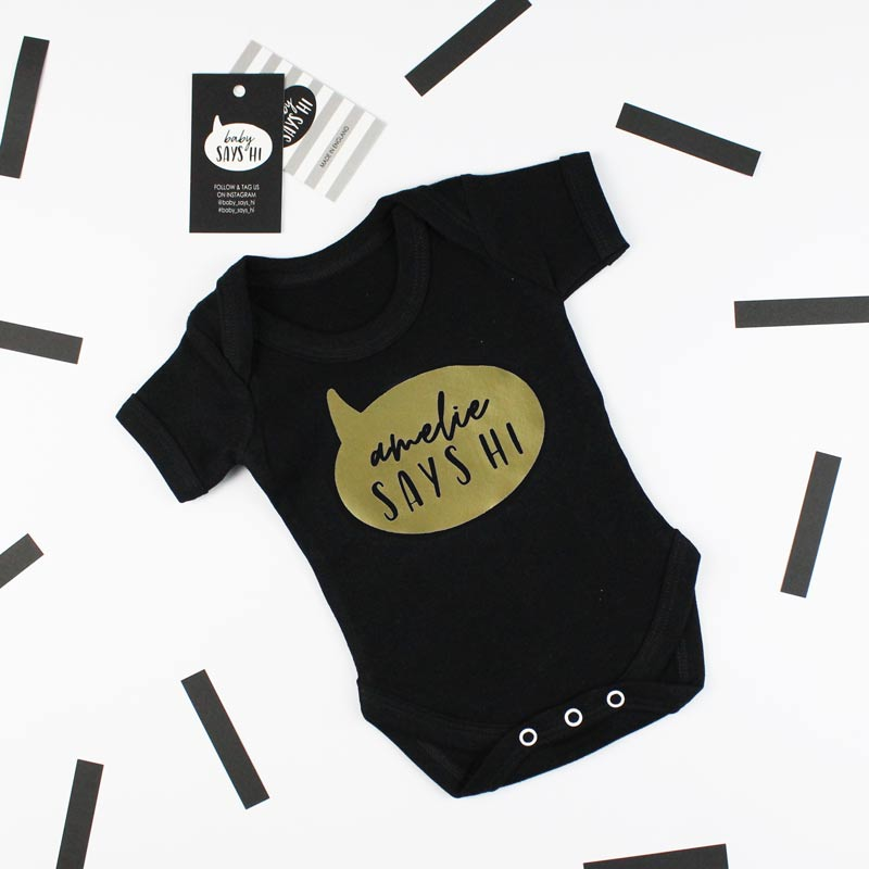 baby says hi black t shirt with gold writing