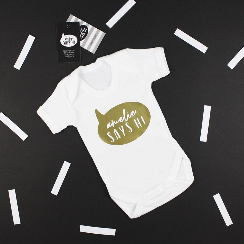 baby says hi white t shirt with gold writing